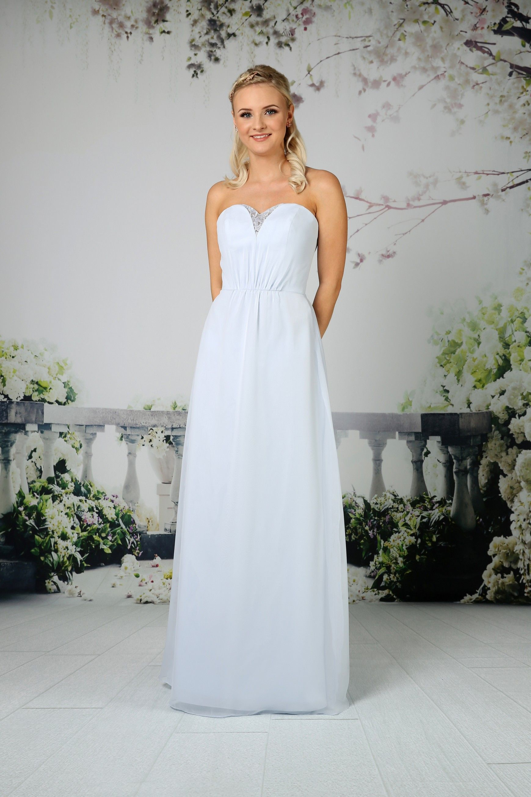 This stunning strapless sweetheart gown has sheer illusion
