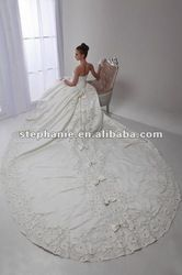 Beautiful wedding dress with a royal cathedral length train.