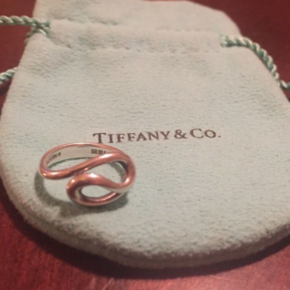 Authentic Tiffany and Co. Open Wave Ring size 4.5 This is an authentic Tiffany & co. Elsa Peretti ring.  I wore this ring before I got married and now I don't need it anymore.  It is sterling silver and a size 4.5.  Normal slight scratches and scuffs from wear.  Will include Blue jewelry bag pictured! Please message with any questions. Tiffany & Co. Jewelry Rings