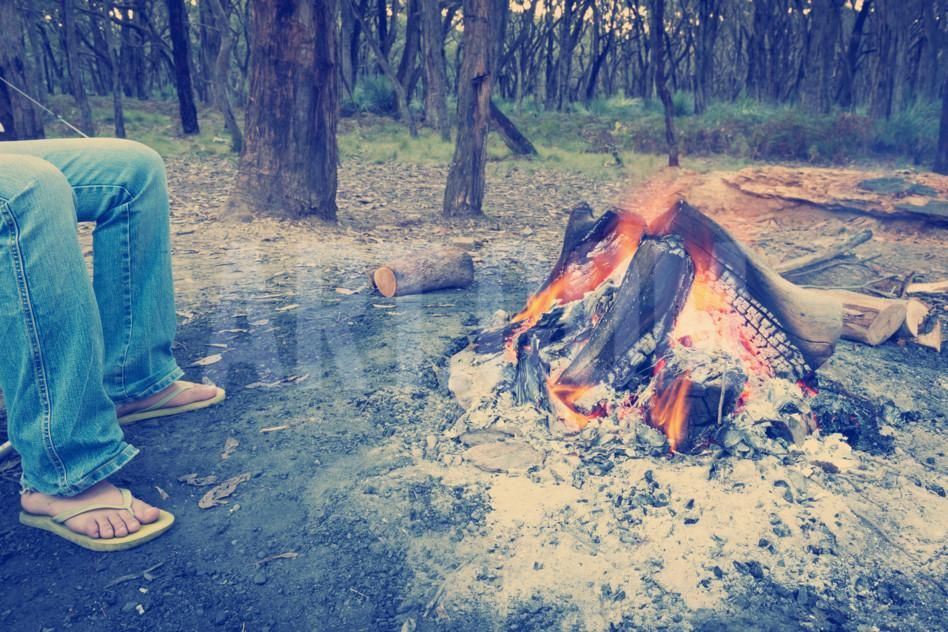 Warming Feet by Campfire Instagram Style Photographic Print by THPStock at…