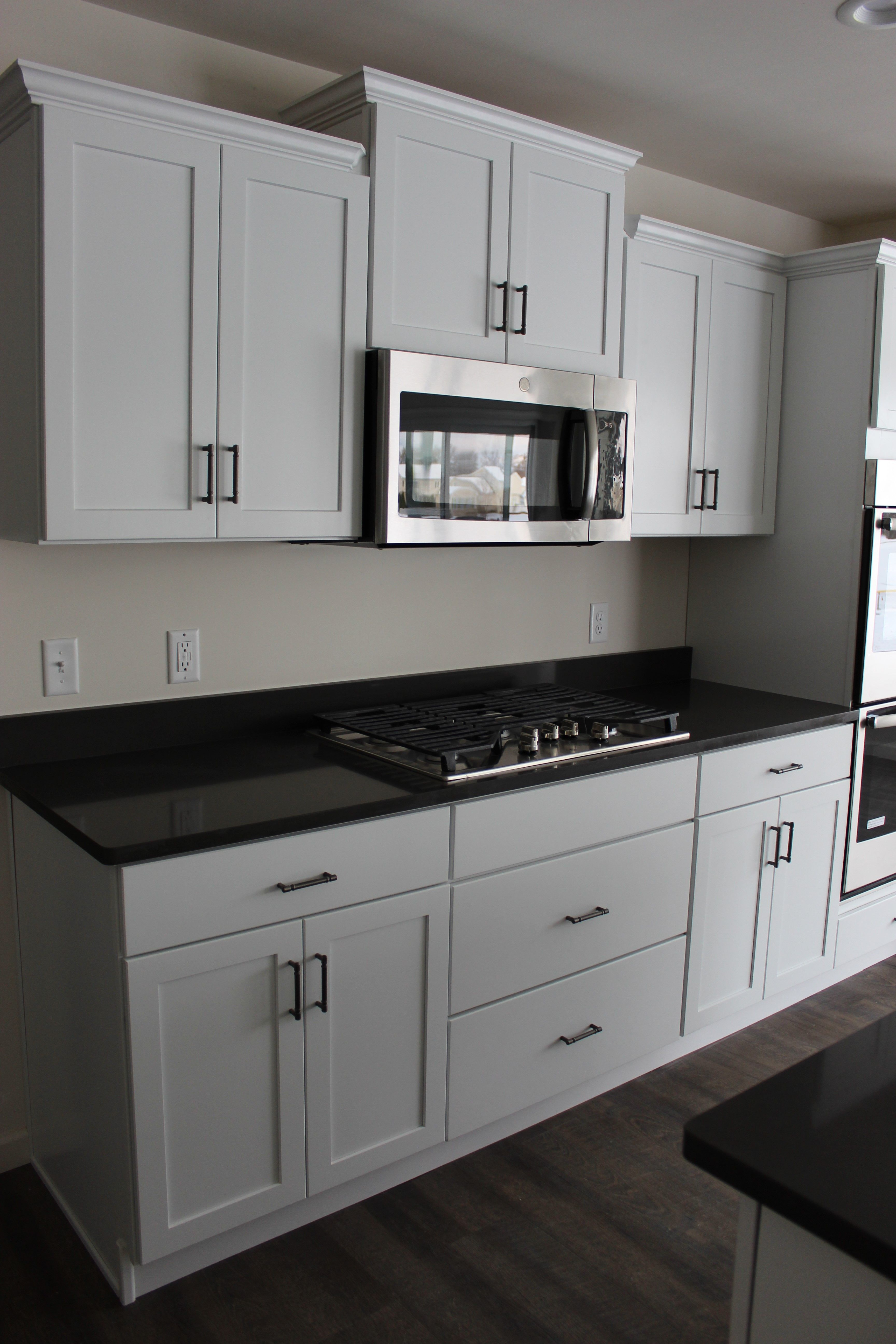 another beautiful farmhouse inspired kitchen with white cabinets and black countertops so eleg on kitchen decor black countertop id=77785
