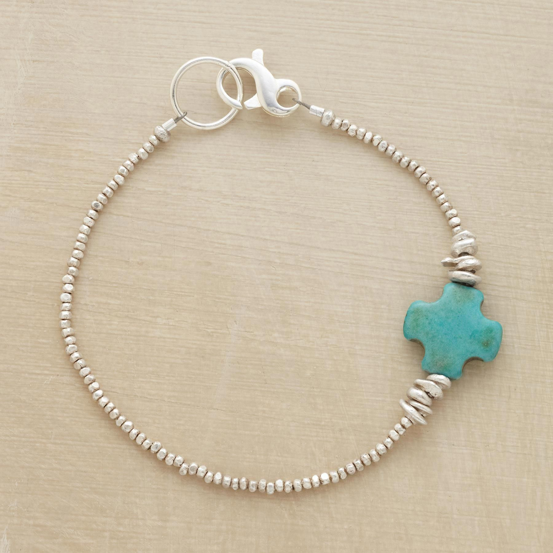 """SOUL CROSS BRACELET�--�The simplest cross carved in sky blue turquoise is a talisman of peace on our bracelet of tiny faceted silver beads. Sterling lobster clasp. Made in USA. Exclusive. Approx. 7-1/2""""L."""