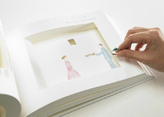 a book with hidden slot for engagement ring Creative marriage