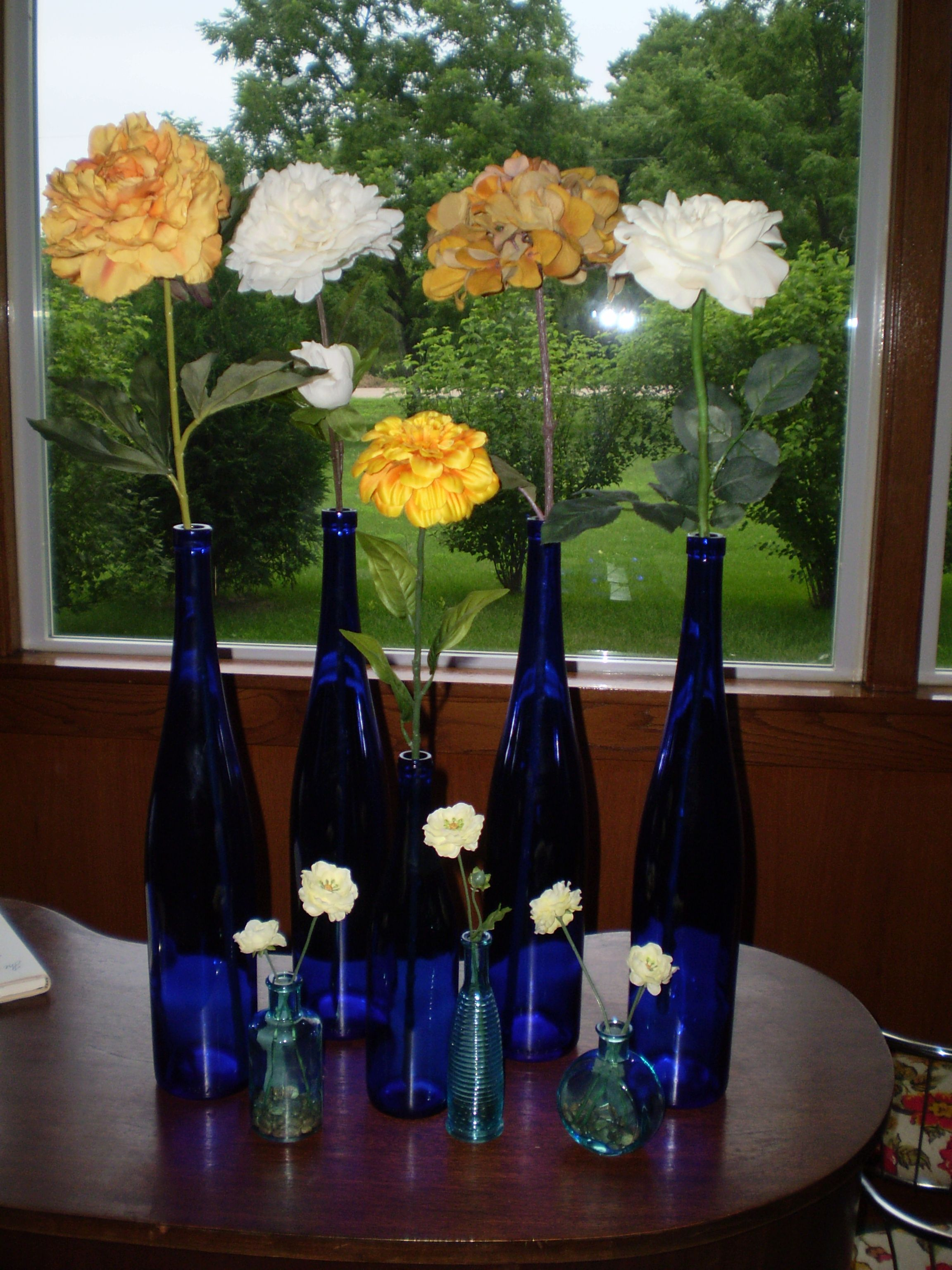 Blue Wine Bottles With Single Flowers Concept Not Execution I Think Trader Joes