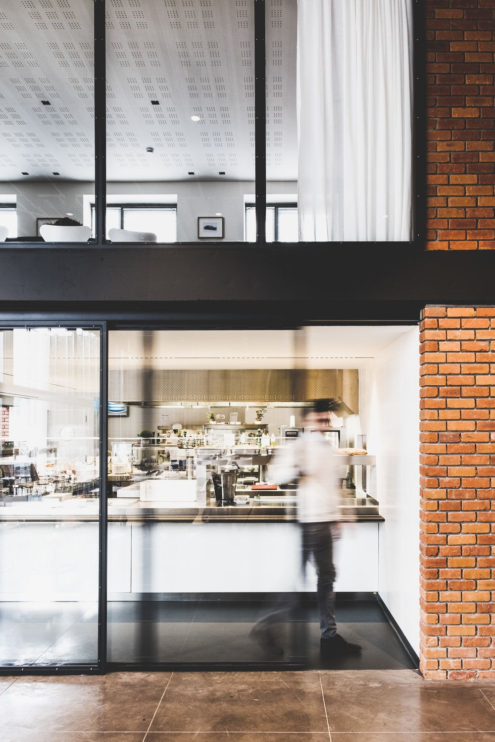 A self service restaurant with an open kitchen and sliding