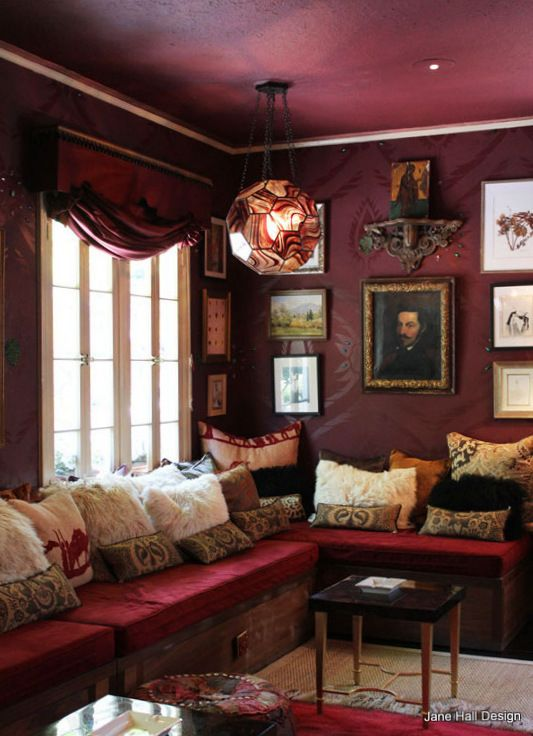 Bohemian style living room with garnet red upholstery and for Plum living room ideas