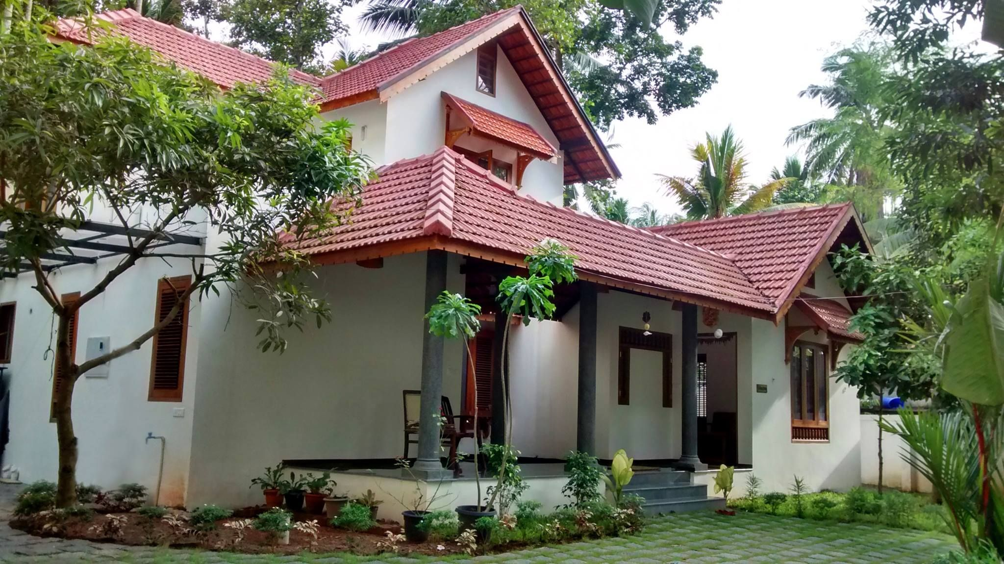 Traditional kerala style residence designed around an for Conventional style home