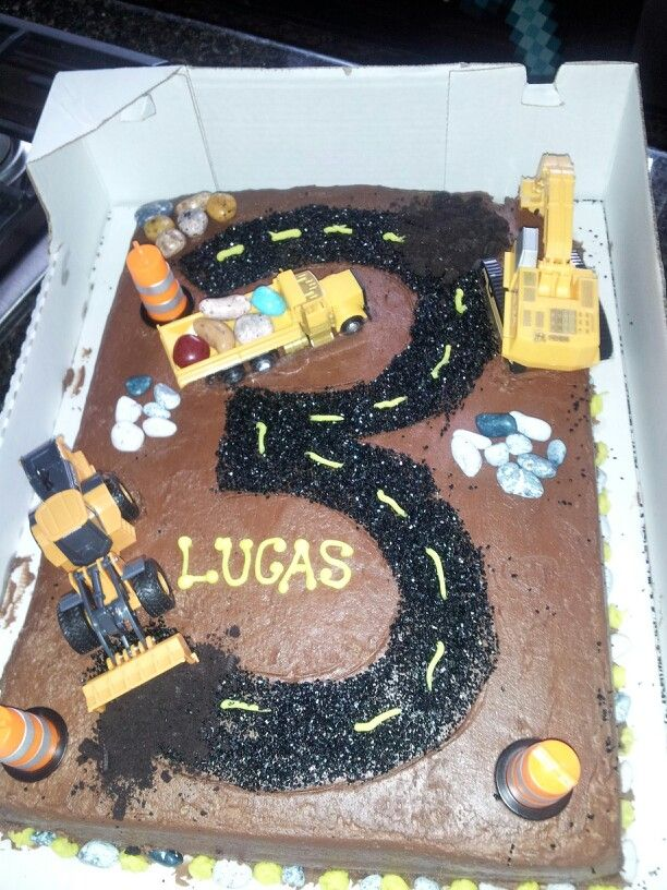 Lucas' construction cake... purchased a blank chocolate cake at Costco and decorated the cake with construction theme toys, rocks, jelly bean rocks from a local cake supply store.  Used black sugar crystals for the road instead of icing- less messy...
