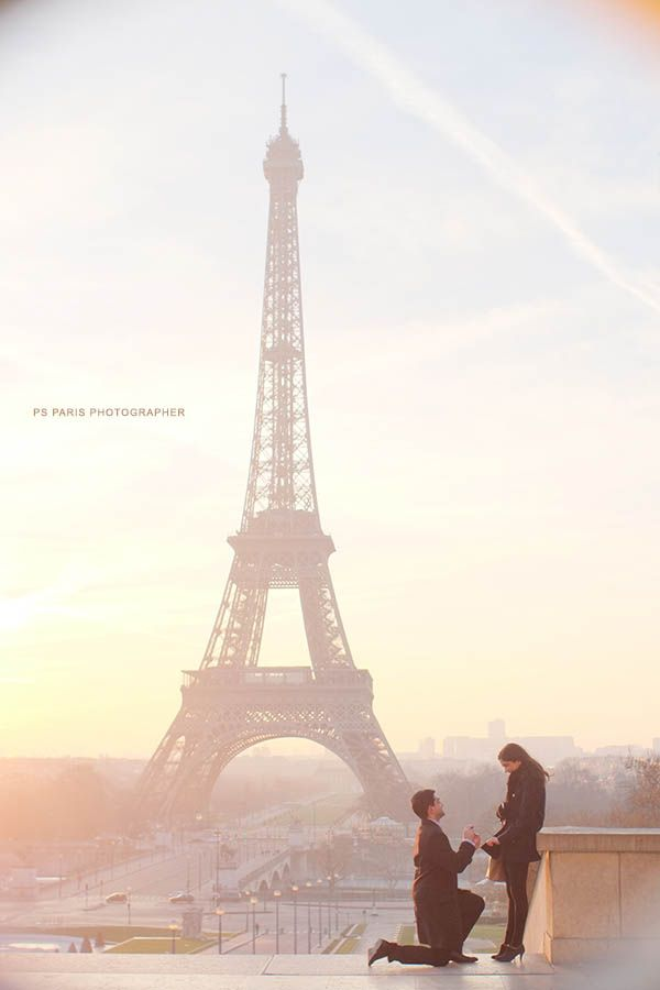 proposal in front of eiffel tower during sunset wedding