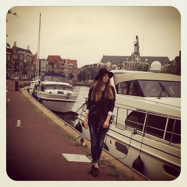 simple and comfy outfit on the rainy day in Haarlem. hat - white  shirt - jeans - leather jacket
