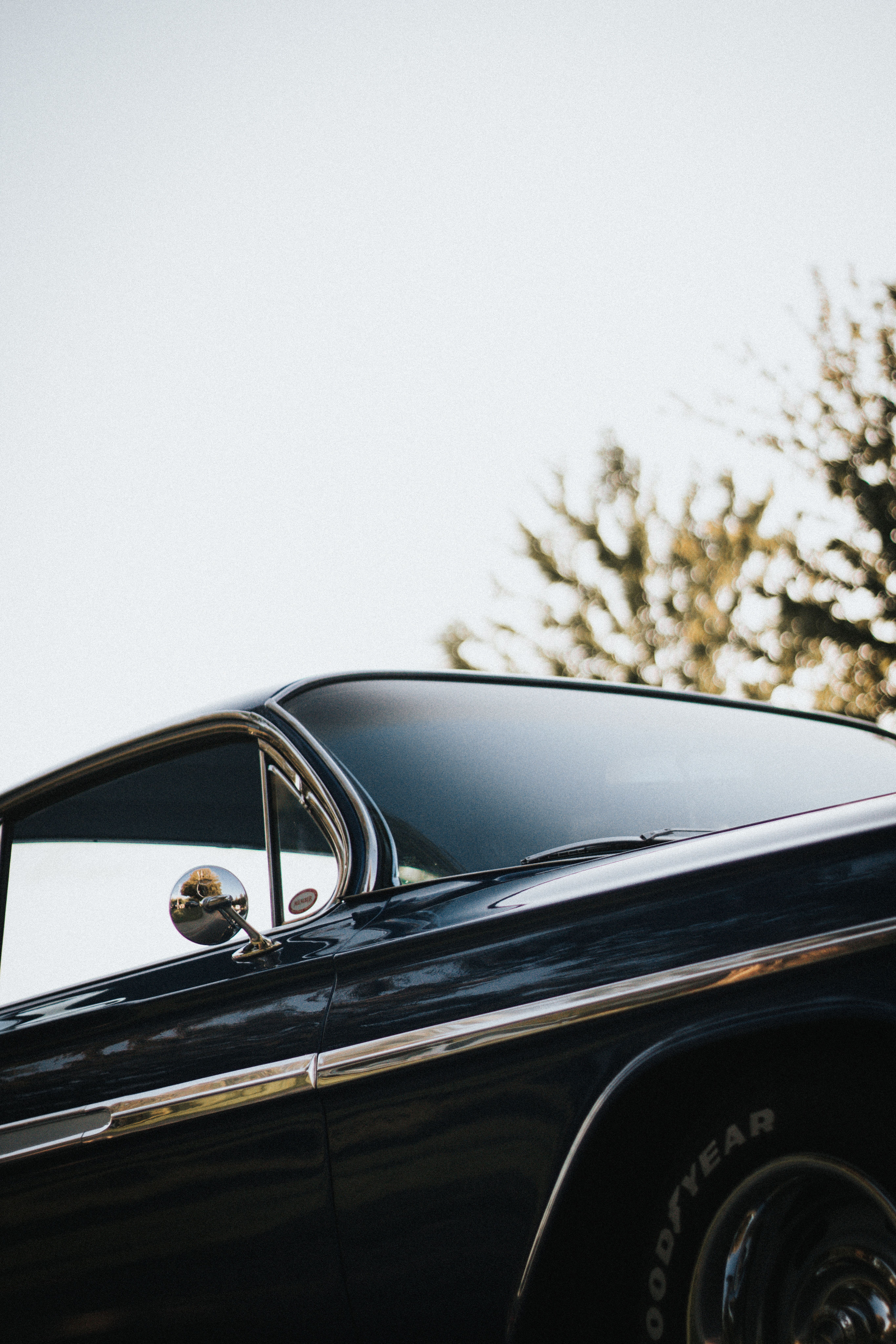 A Low Angle Shot Of A Black Vintage Car In 2020 Car Photography Iphone Wallpaper Vintage Car Wallpapers