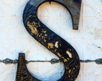 Salvaged tin ceiling tile letter S