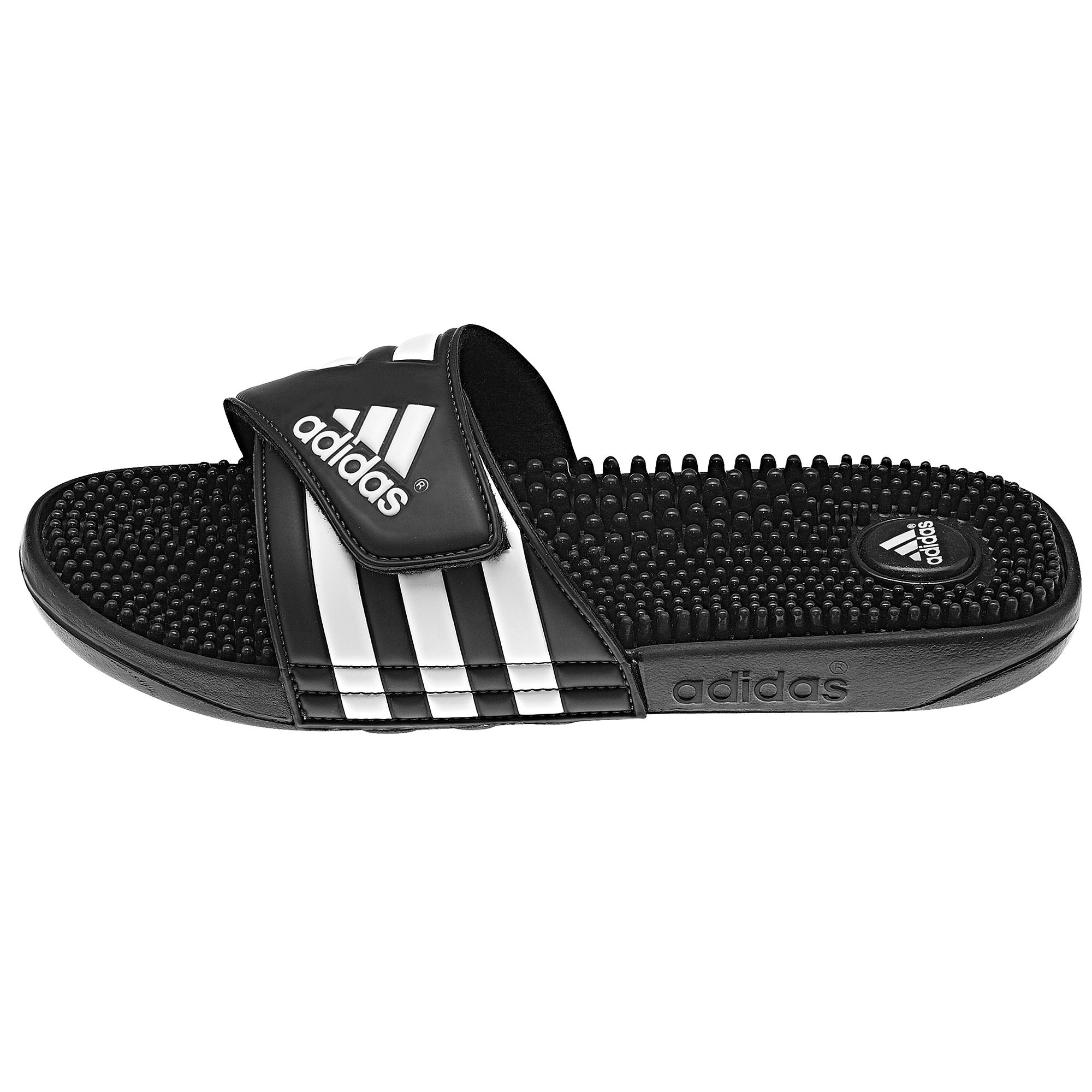 c449fe158b5fc4 The kids  adissage Slides by adidas take all the plush comfort of the adult  slide and size it down for kids. They have the easy on-and-off synthetic  strap ...