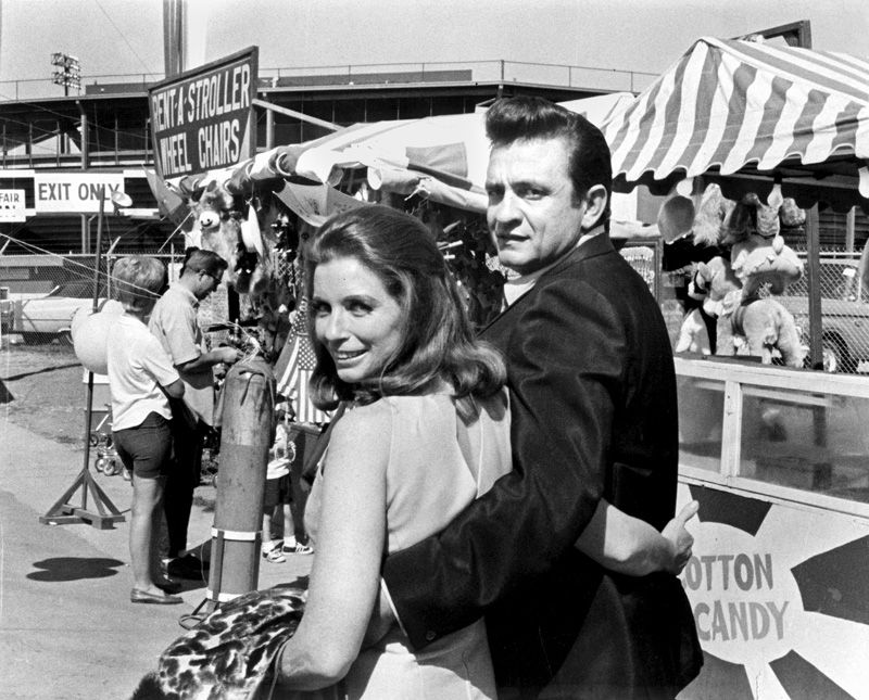 Johnny Cash, with his wife June Carter Cash, on the midway at the Mid-South Fair in 1968.