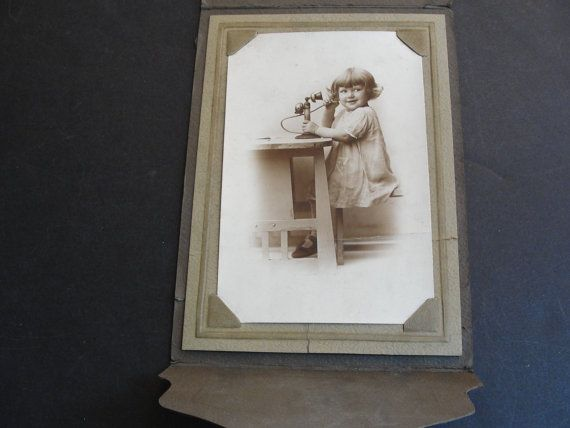 For your consideration is a Lovely,  Vintage Early 1900's - Pretty Young Girl Holding Pedestal Desk Phone on the Table (Portfolio View)- Black-White