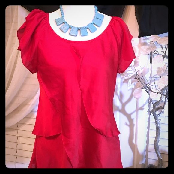 Violet & Claire red blouse Beautiful and unique style , 100% polyester shell and lining , the back falls in a X shape , waives in front and back , it's just gorgeous! Violet & Claire Tops Blouses