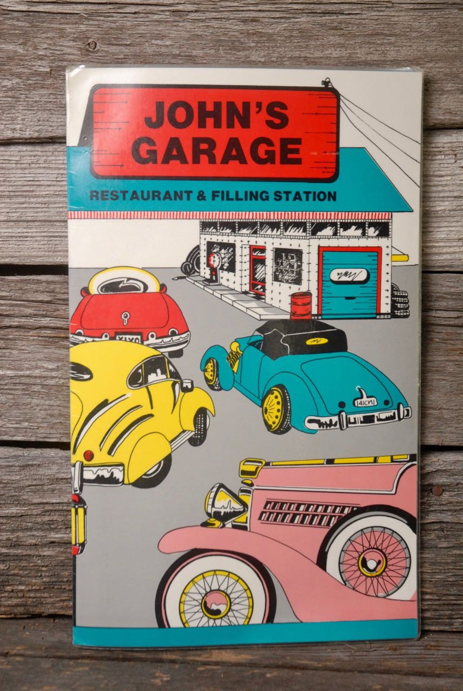 Front & back menu cover of John's Garage Restaurant. It