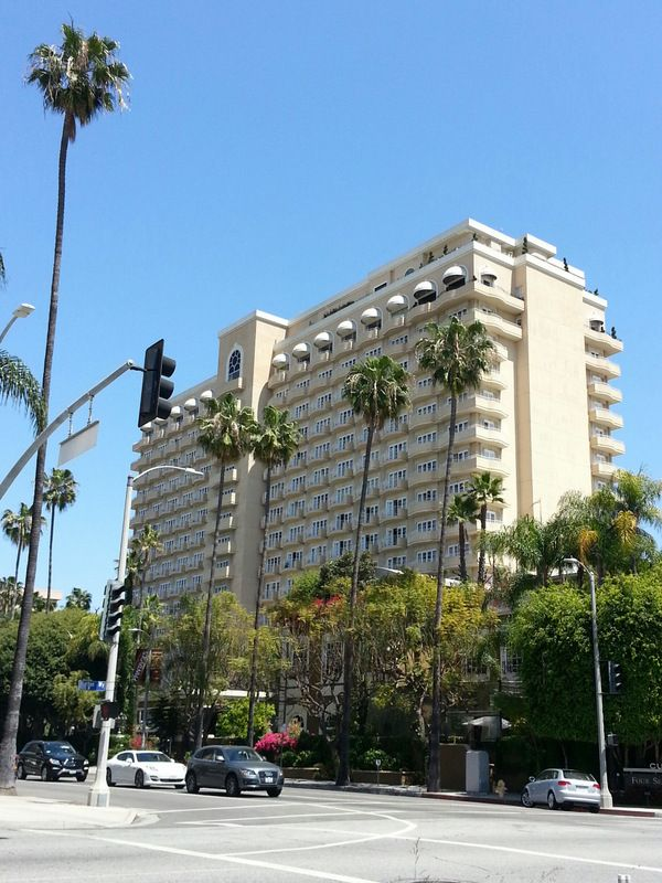 The Four Seasons Beverly Hills Stands Tall Against A Blue