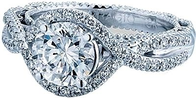 Verragio Twist Halo Diamond Engagement Ring  : This diamond engagement ring setting from Verragio's Venetian collection features pave set round brilliant cut diamonds set along a twist shank going around the center stone of your choice.4600.00