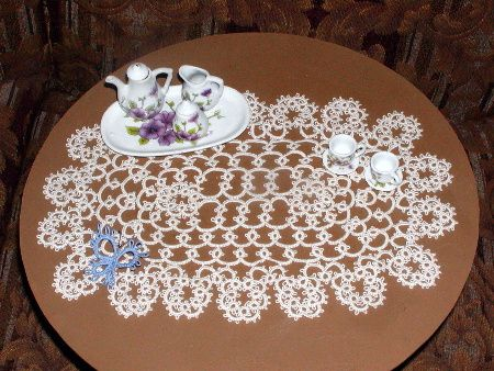 By Mrs. John. The pattern: the Occasional Doily from Tatting Doilies and Edgings,edited by Rita Weiss, Dover 1980.