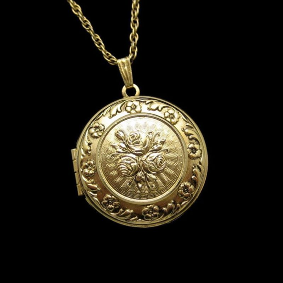 LOVELY VICTORIAN STYLE LOCKET! I think the 1928 Company makes some of the loveliest Victorian Revival jewelry. This engraved locket is just beautiful and would make a wonderful Mother's Day gift - just put a couple of photos inside. $49.95. See this and more great vintage necklaces in my eBay store: http://stores.ebay.com/My-Classic-Jewelry-Shop/Necklaces-/_i.html?_fsub=1589284016&_sid=102404336&_trksid=p4634.c0.m322