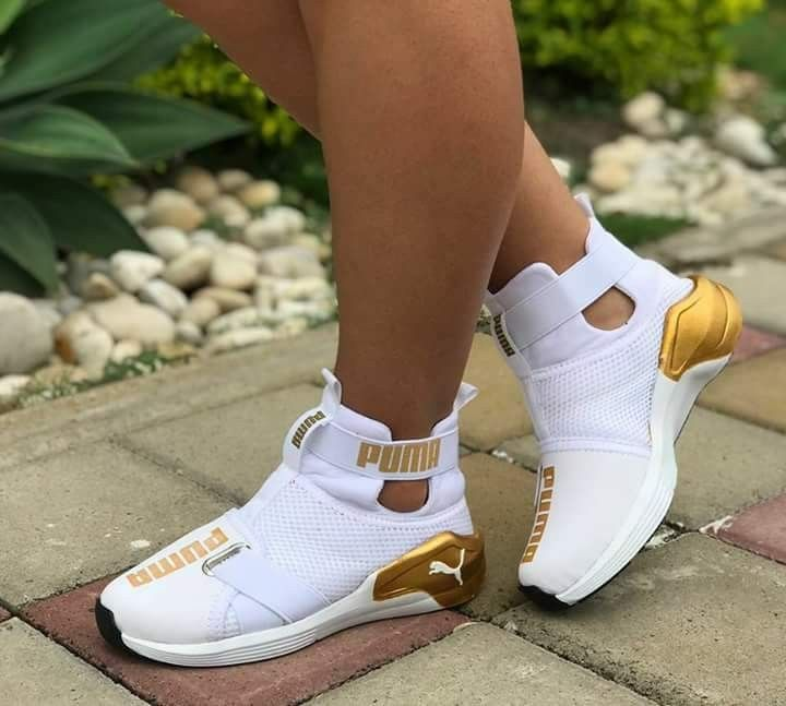 white and gold pumas with strap
