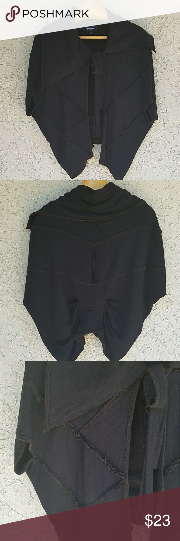 Bebe Black Jersey Cape Jacket Black jersey cape with ruching on back side, neck sash closure and arm holes.  Excellent condition. bebe Jackets & Coats Capes