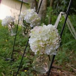 Hanging Mason Jars - love the lights in the bottom and that they used ribbon!