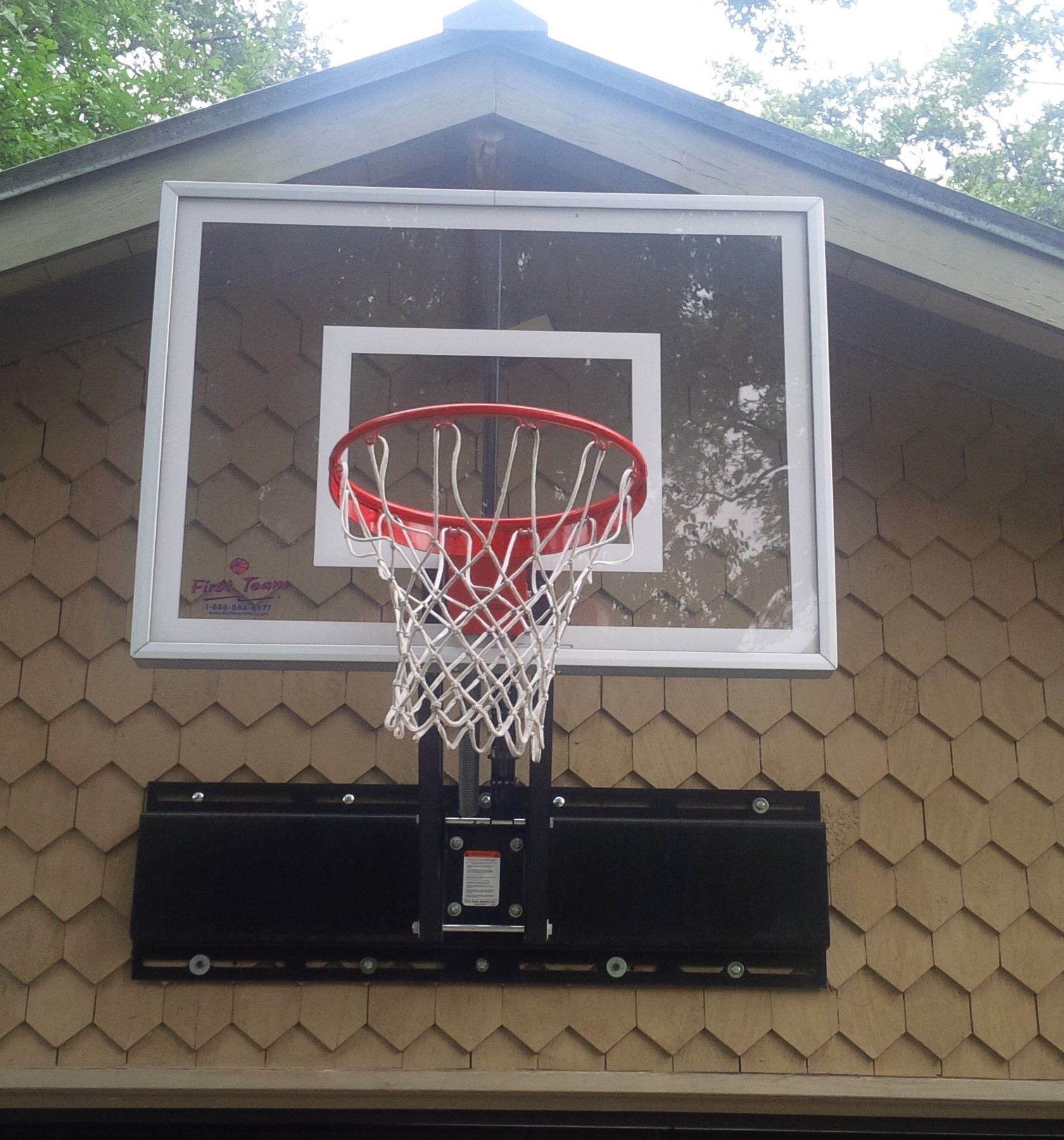 Here Is A Great Photo Of A Unichamp Ii Adjustable Basketball Goal Made By First Team The Unit I Basketball Hoop Driveway Basketball Goals Backyard Basketball
