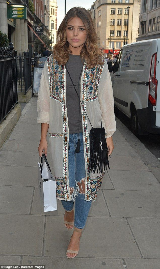 Chloe Lewis works casual glamour in sheer cardigan and ripped jeans