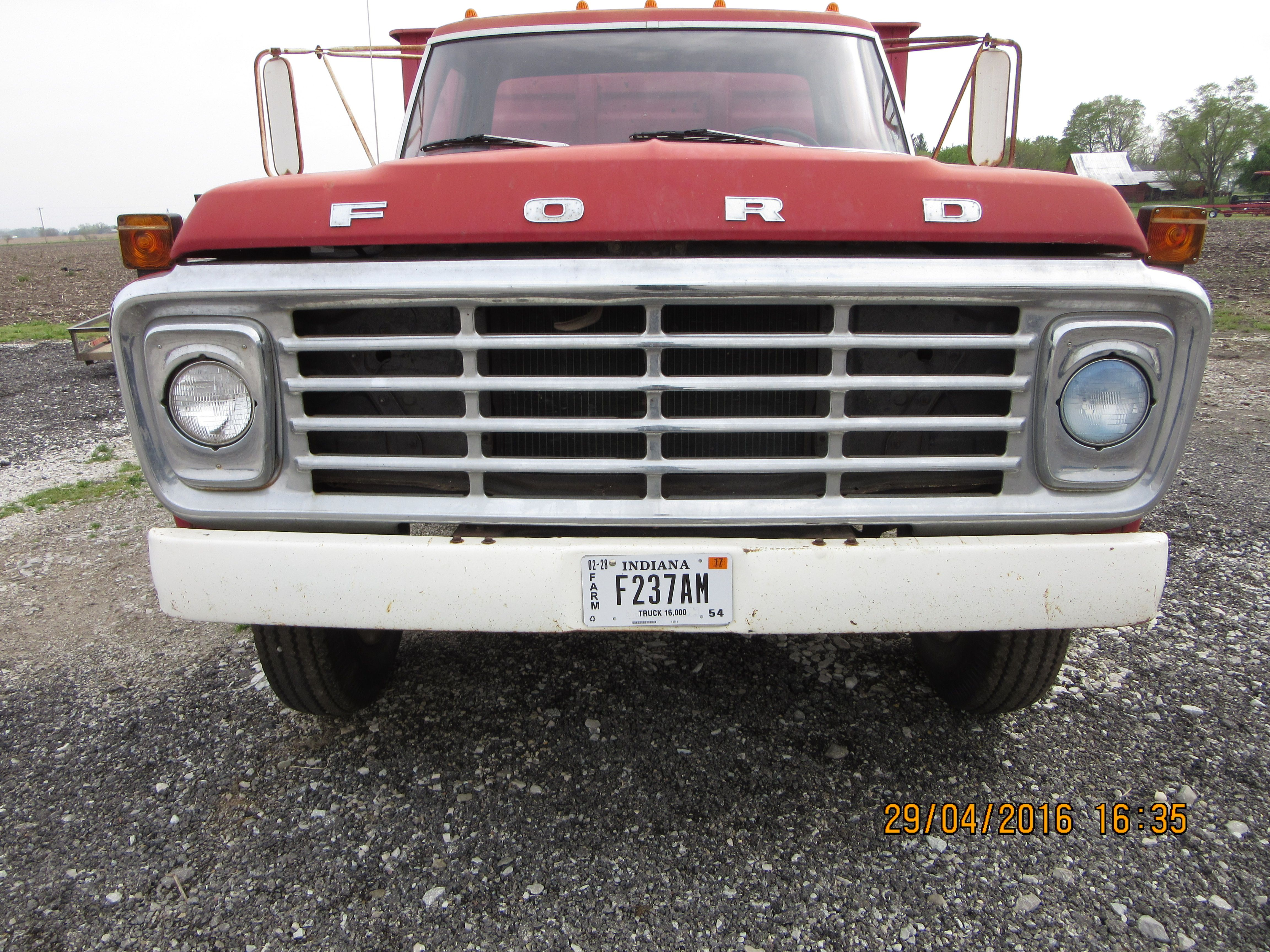 Front grill of red ford f600 grain truck growing up i was so impressed with