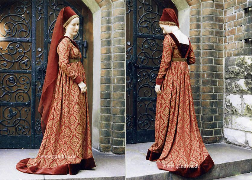 Burgundy gown, c. 1400. This medieval era dress was made from antique red and gold fabric, with the typical ornamentation of pattern of late Burgundian era. It is cut with a high waist, which is accented with an antique gold belt. Silk and velvet neck. Tight sleeves. Hennin with veil. http://www.historical-costumes.eu/de/Mittelalter.html