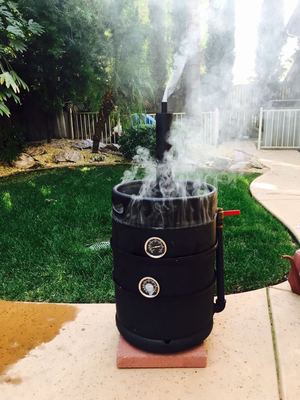 Diy meat smoker made from a keg shell