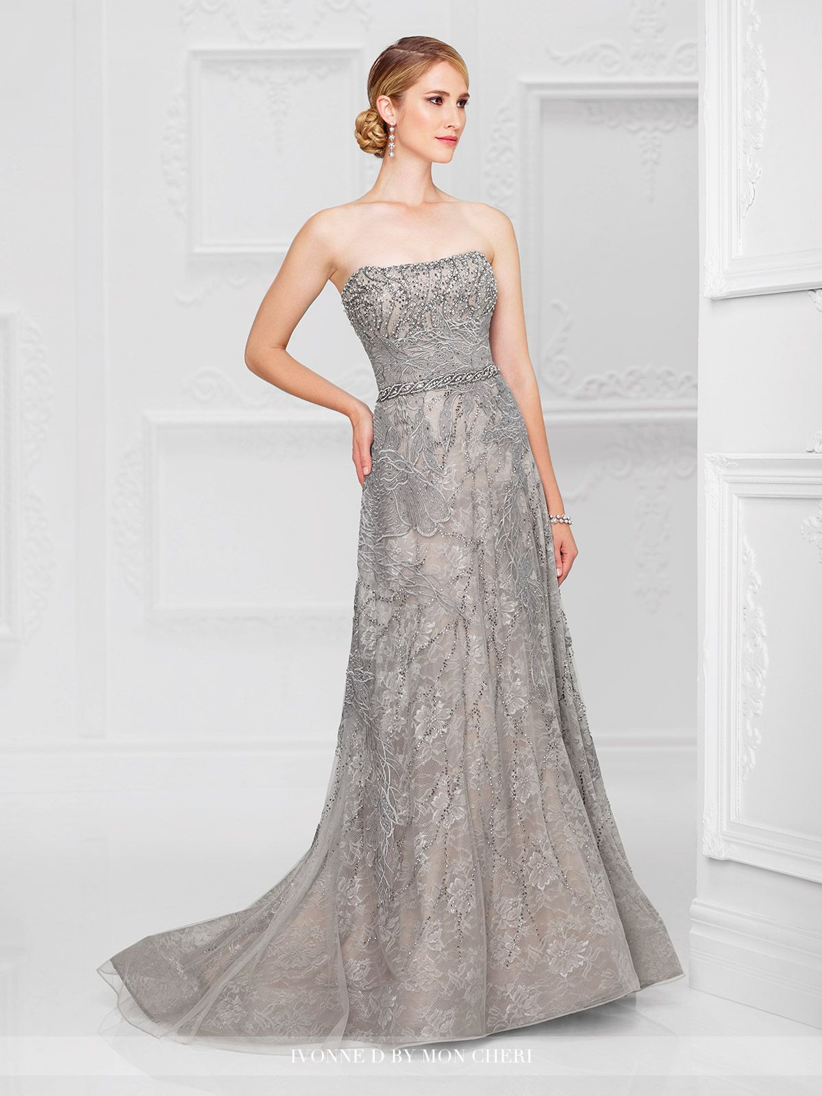 Strapless embroidered tulle A-line gown with hand-beaded curved neckline, beaded natural waistband, horsehair hemline, sweep train. Removable straps included. Sizes: 4 – 20 Colors: Gray, Navy Blue