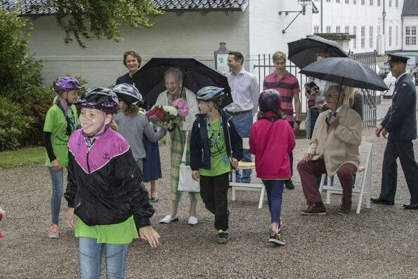 On July 17, 2016, Queen Margrethe II of Denmark and Prince Henrik watched the Gråsten Ring Rider Association's annual parade outside the gates of Gråsten Palace, the summer residence of the royal fami