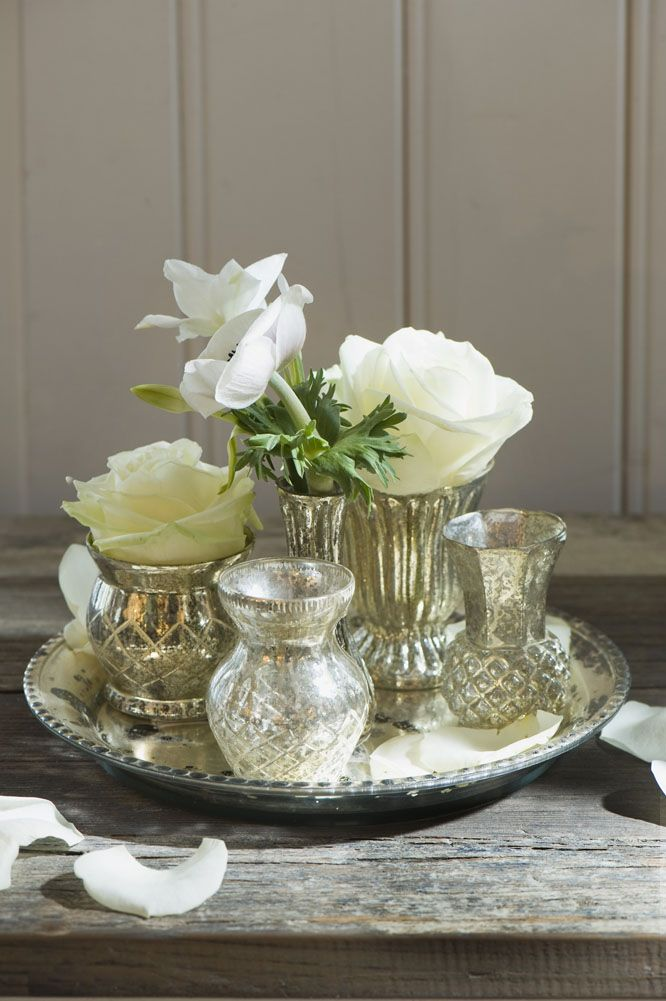 Silver Tray Filled With Mercury Vases And White Blooms In