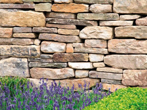 dry stacked stone wall adds architecture