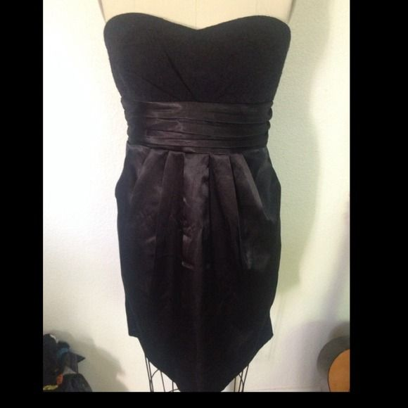 Black tub top silk dress Black lace tub top and silk bottom dress. With hidden front pockets. NWT Perfect for the New Year! Dresses
