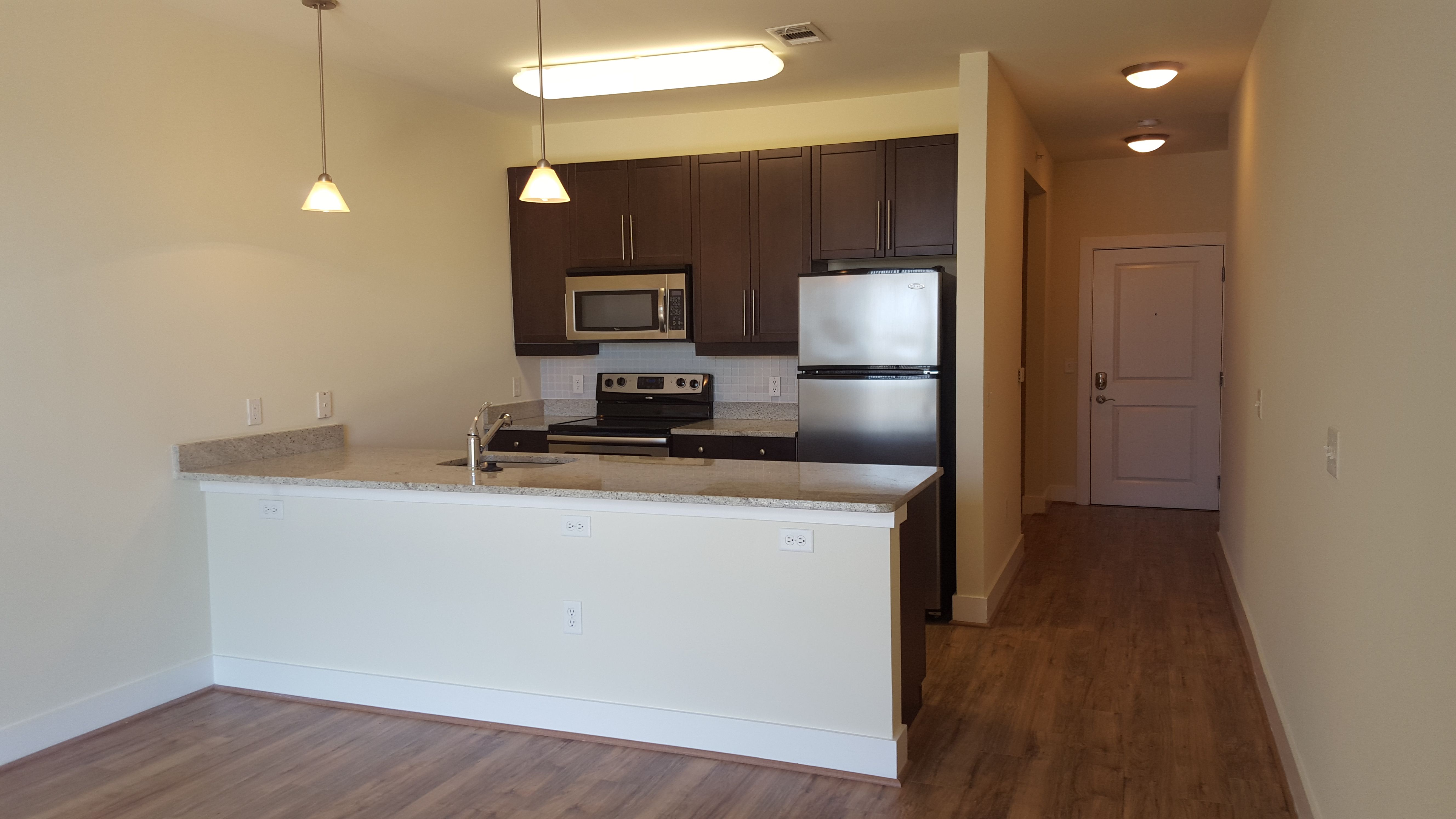 Top Floor Studio Apartment With Wood Flooring At 800 Carlyle Apartments Pendantlighting Whitegranite Tallceilings St Apartment Tall Ceilings White Granite