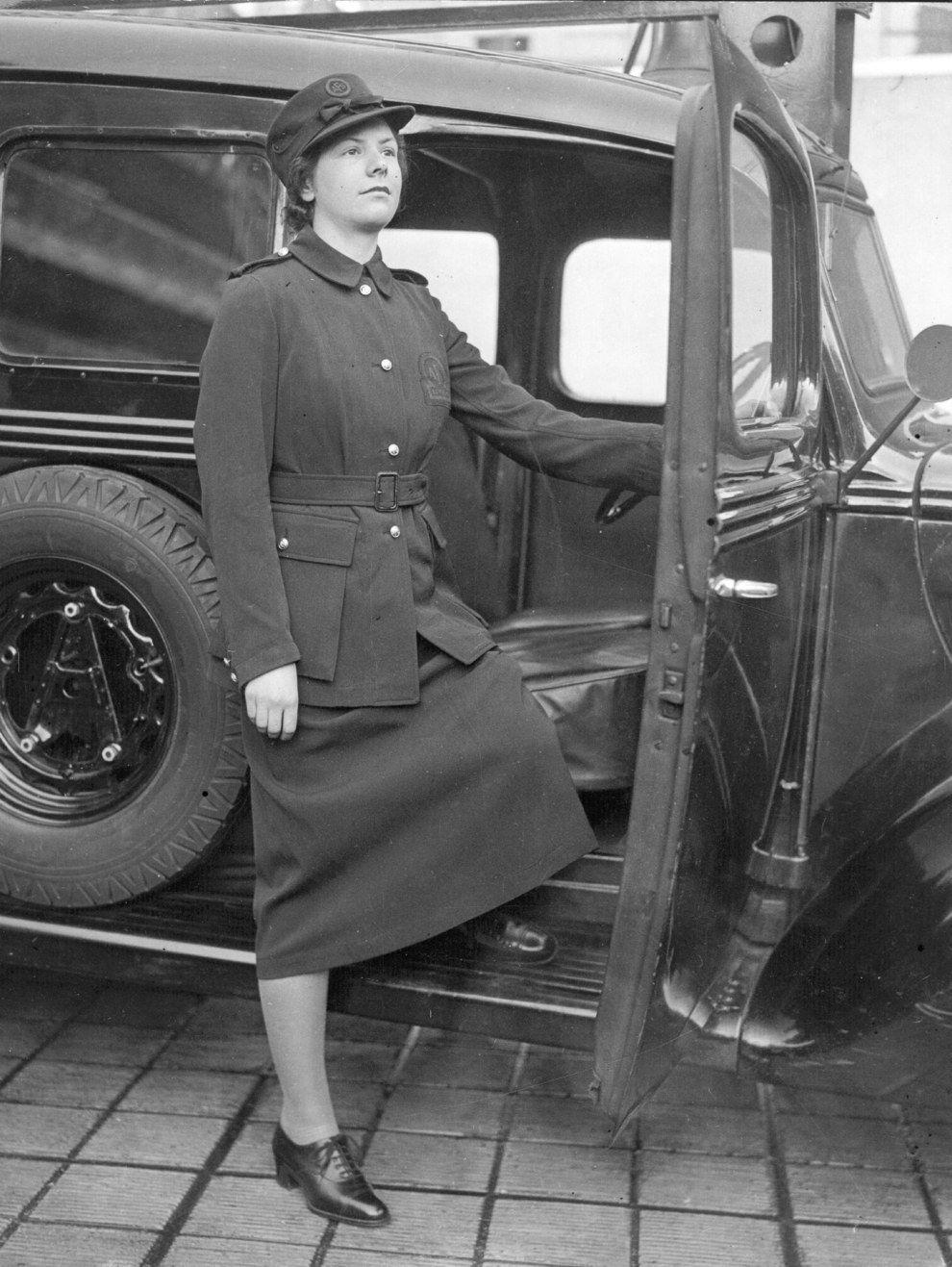 1938 a female firefighter models a new uniform female