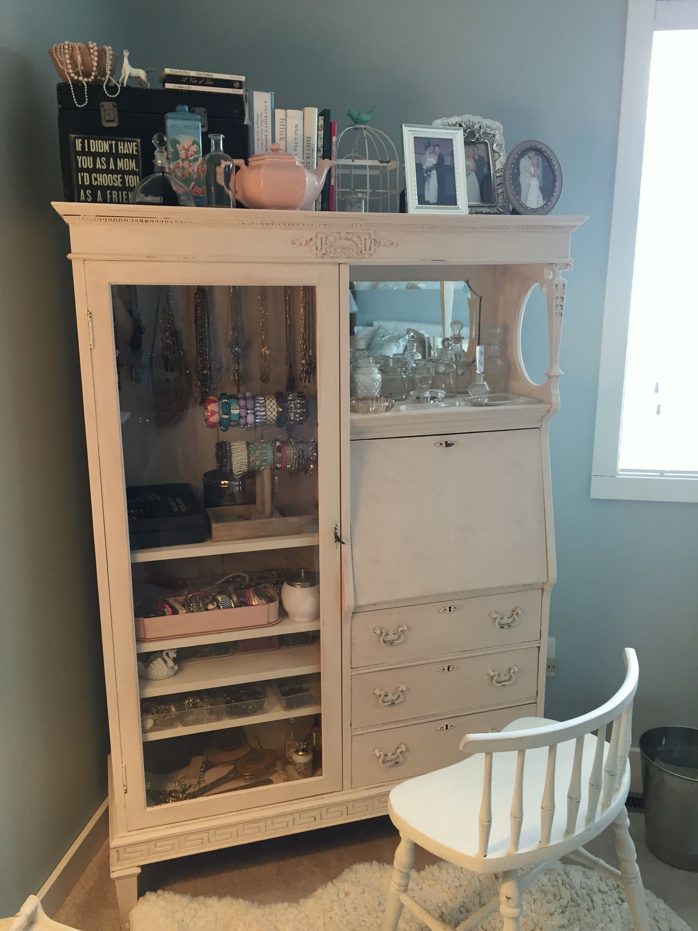 Turned old secretary into jewelry storage and hair