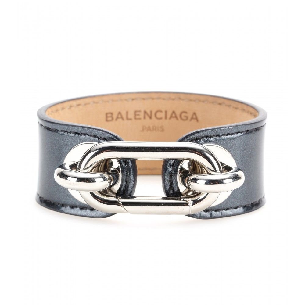 Balenciaga - Maillon patent leather bracelet - There's no hiding from an achingly cool accessory, especially when it's a Balenciaga offering. The glossy finish of this simple grey leather band is topped with the label's signature maillon clasp - a key theme throughout the collection. Roll up your sleeves and let it amp up your crisp white shirt. seen @ www.mytheresa.com