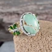 Glowing with the kiss of Russian diopside and diamond, you cannot resist falling for Utah Variscite ring. Fashioned in Sterling Silver with platinum and 14K Yellow Gold overlay, this ring shimmers and dazzles to enchant. Free ShippingGift Box