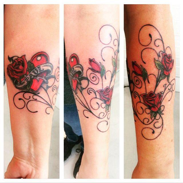 Rose swirls tattoo