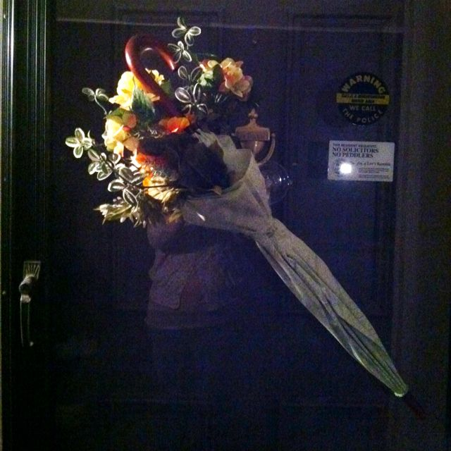 Stuff an umbrella with artificial flowers for a unique decoration that will make your front door stand out from the ones of the apartments around you.