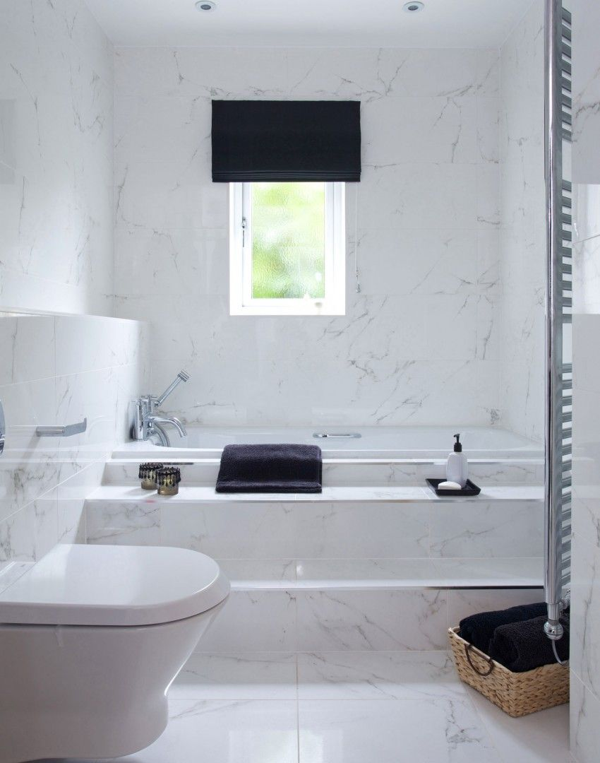 All over marble tiling gives this bathroom a luxurious, spa-like ...