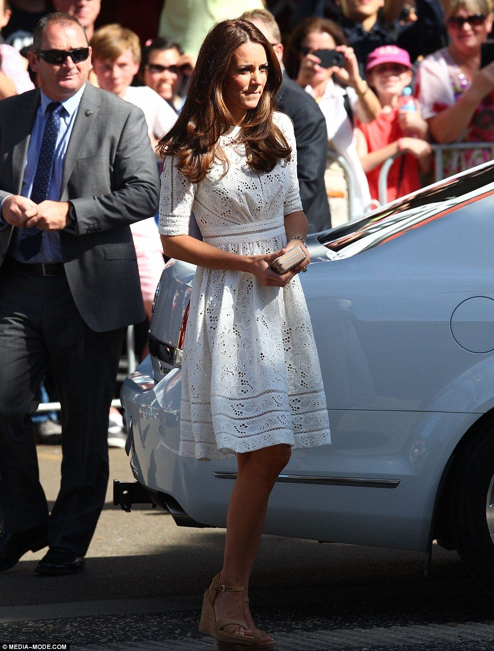 Kate Summery and stunning: Kate's white laser cut dress looked stunning on her slender frame and she paired the attire with some tan cork wedges