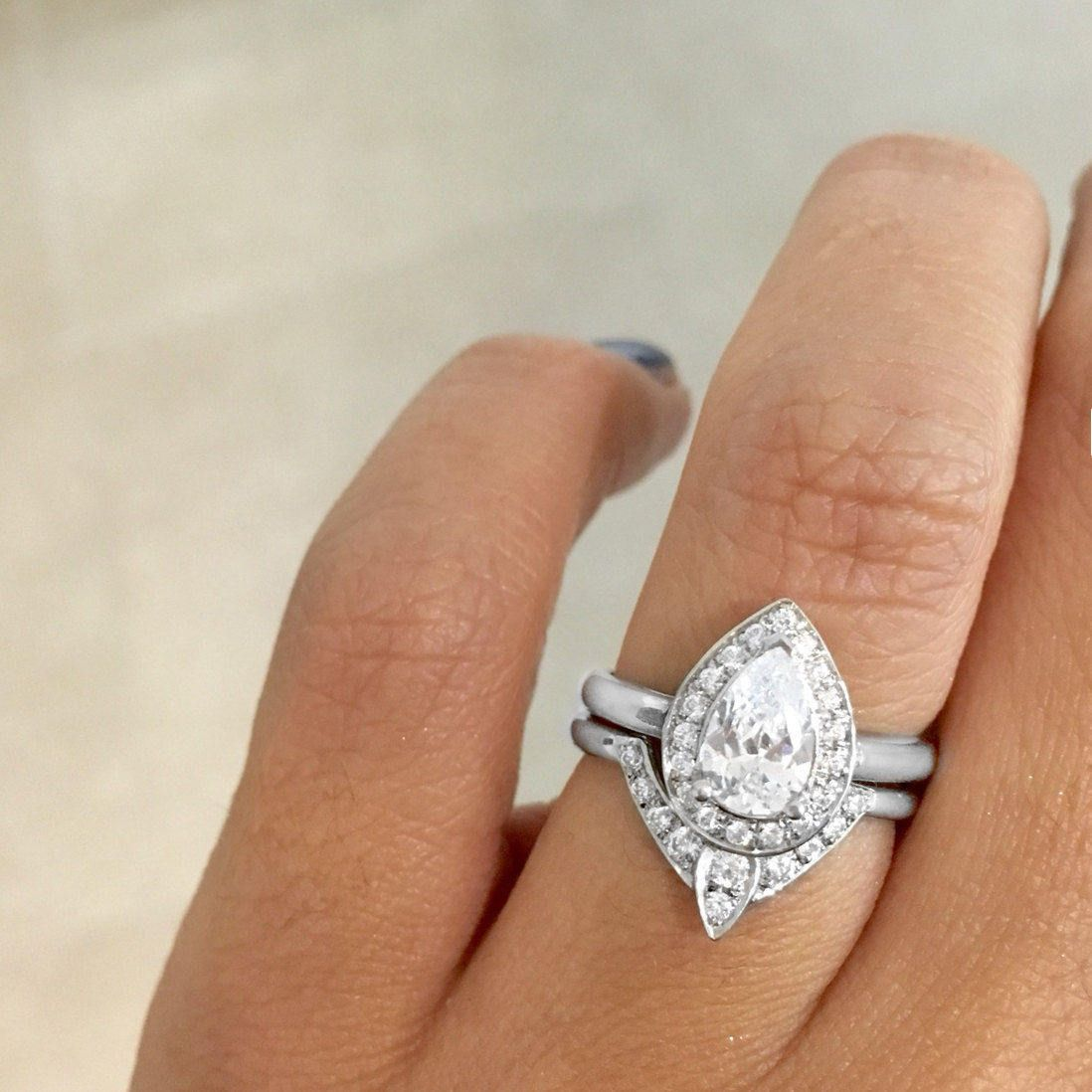 Pear morganite engagement ring with matching side diamond band the