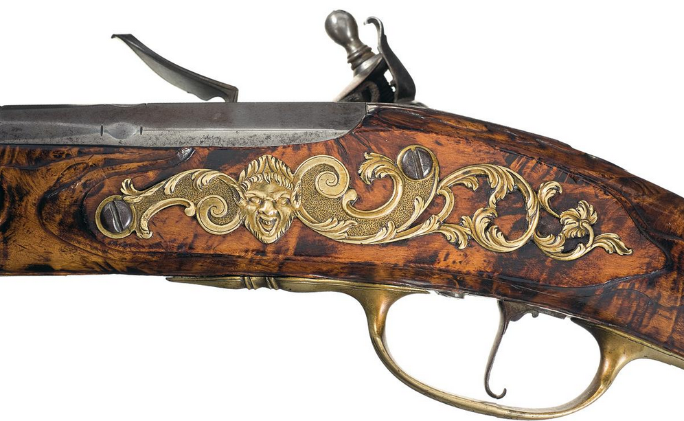Late 18th century flintlock carbine with beautiful maple stock.