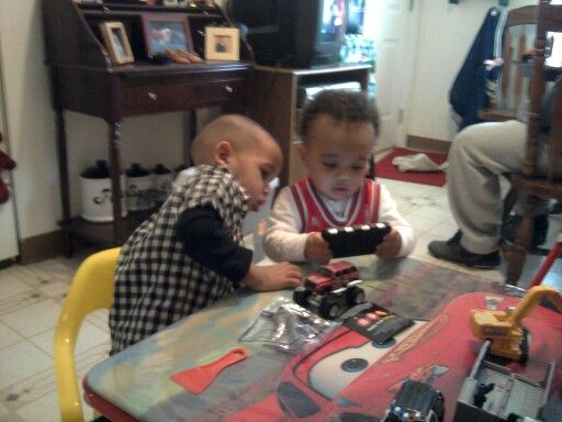 Xavier& Josiah...checking out a flick on Unk Tren phone lol...